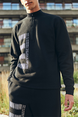 black tracksuit with white print by Soul Seeker